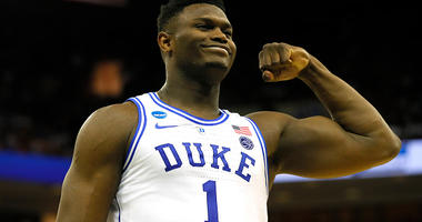 Zion Williamson flexes his muscles.