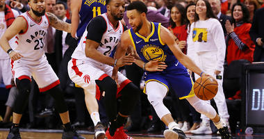 Stephen Curry drives against the Toronto Raptors in Game 5 of the NBA Finals.