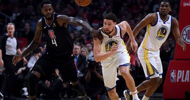 Klay Thompson chases a loose ball.