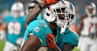Miami Dolphins wide receiver Isaiah Ford (84) celebrates his touchdown during the second half against the Tampa Bay Buccaneers at Hard Rock Stadium.
