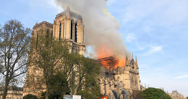 Notre Dame cathedral is burning in Paris, Monday, April 15, 2019. Massive plumes of yellow brown smoke is filling the air above Notre Dame Cathedral and ash is falling on tourists and others around the island that marks the center of Paris.