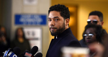 Actor Jussie Smollett talks to the media before leaving Cook County Court after his charges were dropped, Tuesday, March 26, 2019, in Chicago.