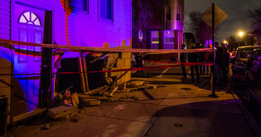 Chicago Fire Department respond to a vehicle into an apartment building Thursday night in Logan Square.