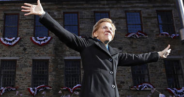Sen. Elizabeth Warren, D-Mass., acknowledges cheers as she takes the stage during an event to formally launch her presidential campaign, Saturday, Feb. 9, 2019, in Lawrence, Mass.