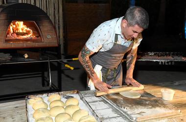 Chef Michael Solomonov rolling dough