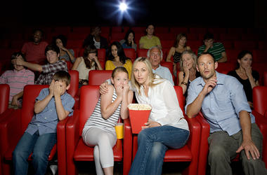 A family enjoys a movie in a theater