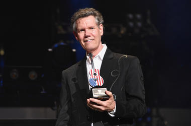 Randy Travis receives an award during the 2018 CMA Music festival