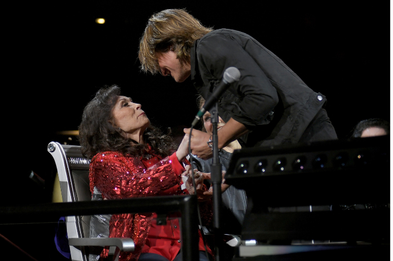 Keith Urban greets Loretta Lynn during Loretta Lynn: An All-Star Birthday Celebration Concert at Bridgestone Arena on April 1, 2019 in Nashville, Tennessee