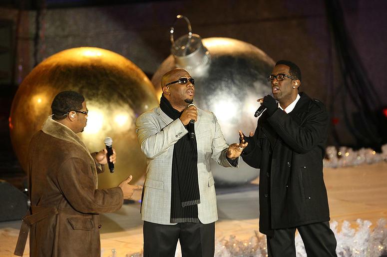 Boyz II Men perform on stage at the Rockefeller Center Christmas tree lighting
