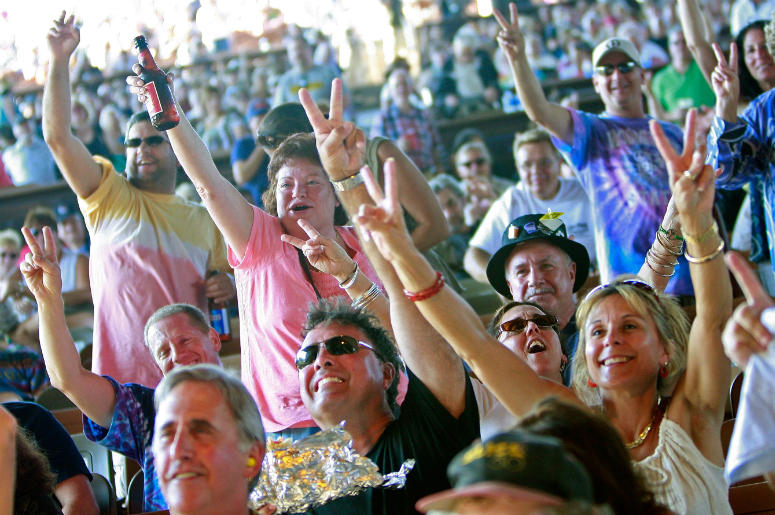 Fans cheer during the concert marking the 40th anniversary of the Woodstock music festival August 15, 2009 in Bethel, New York