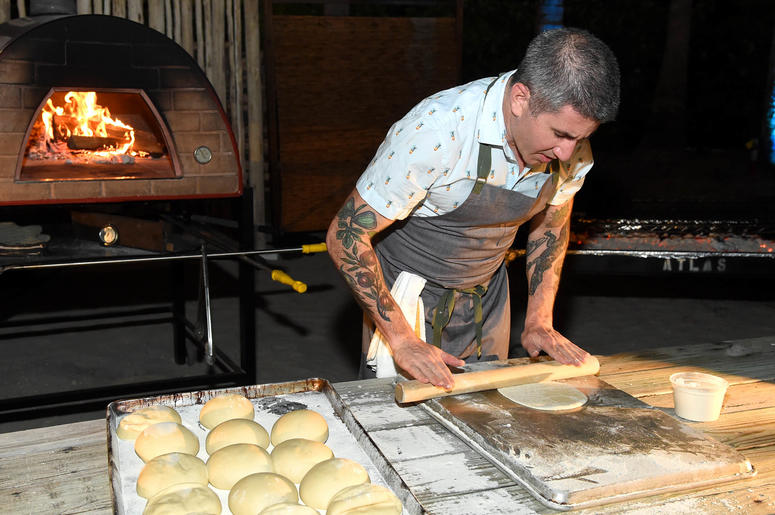 Chef Michael Solomonov rolling dough