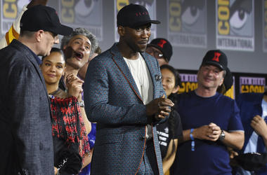 "Mahershala Ali, center, wears a hat to promote his new movie ""Blade"" at the Marvel Studios panel on day three of Comic-Con International on Saturday, July 20, 2019, in San Diego."