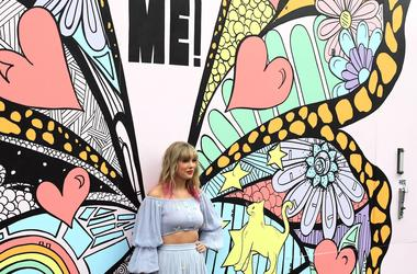 Taylor Swift poses at a butterfly mural in Nashville, Tenn.,