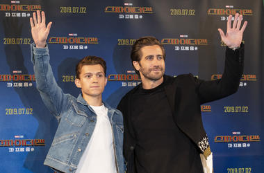 """Actors Tom Holland (L) and Jake Gyllenhaal greet fans during a promotion activity of the film """"Spider-Man: Far From Home"""""""