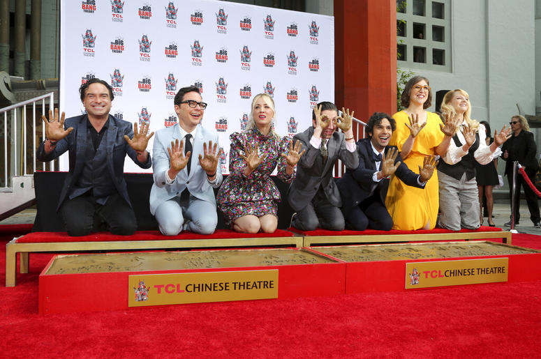 """Johnny Galecki, from left, Jim Parsons, Kaley Cuoco, Simon Helberg, Kunal Nayyar, Mayim Bialik and Melissa Rauch members of the cast of the TV series """"The Big Bang Theory,"""" show their hands after placing them in cement during a hand and footprint ceremony"""