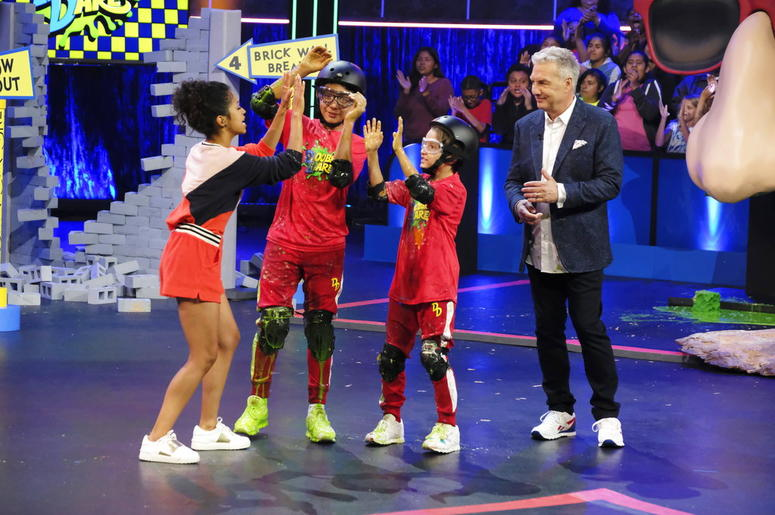 "Marc Summers with contestants on the game show ""Double Dare"""