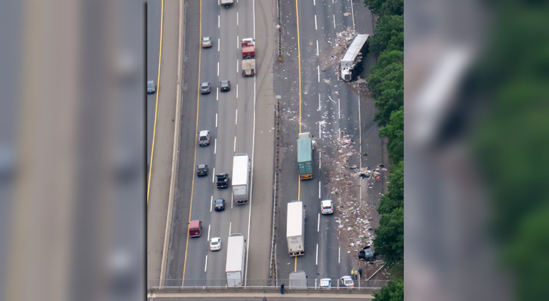 Tractor-Trailer Hauling Trash, Car Collide On New Jersey