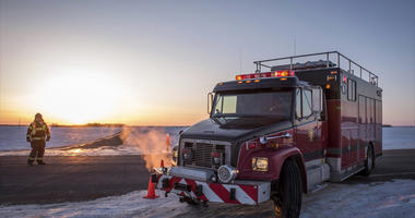 Emergency crews continue to block the highway on Saturday, April 7, 2018, near the area where a bus carrying a junior hockey team to a playoff game was struck by a semi Friday, north of Tisdale, Saskatchewan, Canada. Police say there were 28 people, inclu