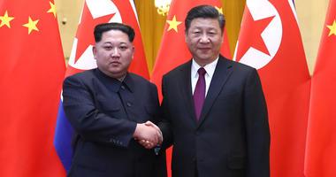 Xi Jinping and Kim Jong Un
