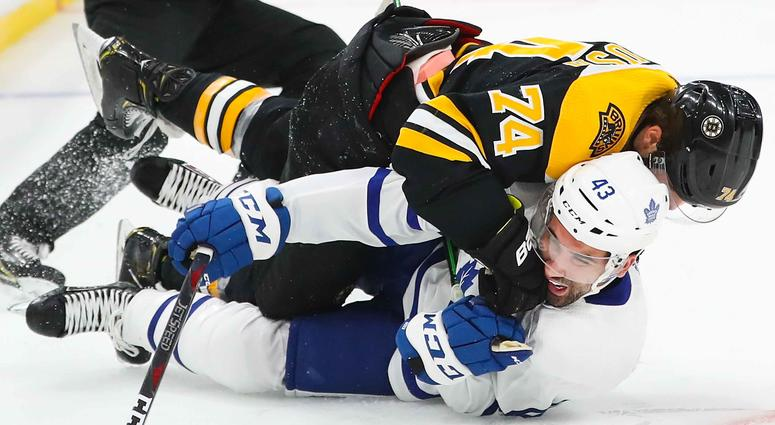 Jake DeBrusk of the Boston Bruins and Nazem Kadri get tangled up during Game 2 of the first round of the NHL playoffs.