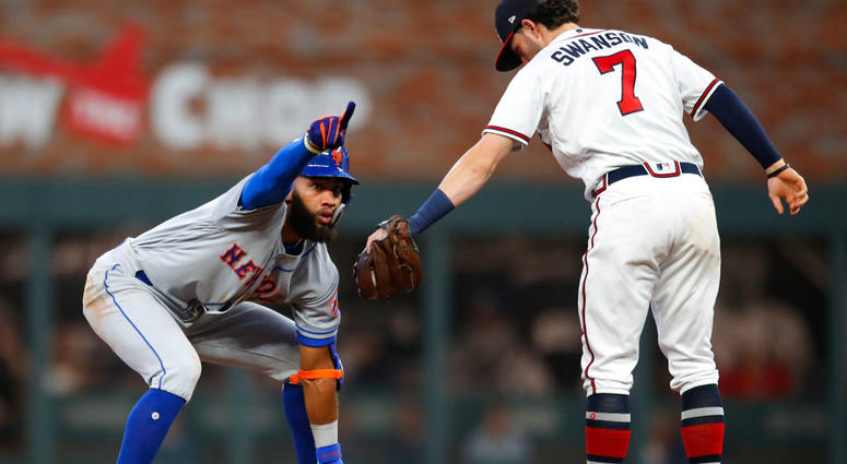 Amed Rosario #1 of the New York Mets reacts after coming up with a double in the fifth inning of an MLB game against the Atlanta Braves at SunTrust Park on June 17, 2019