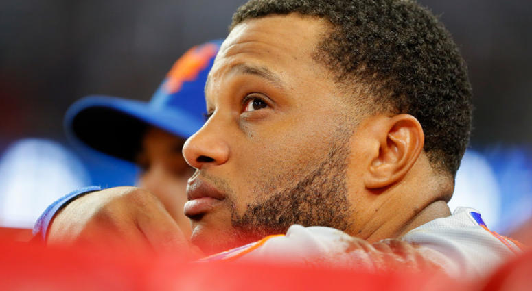 Robinson Cano #24 of the New York Mets looks on in the ninth inning against the Atlanta Braves at SunTrust Park on June 19, 2019