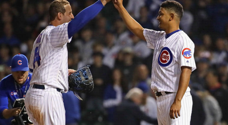 Anthony Rizzo #44 (L) celebrates with Adbert Alzolay #73 after a win against the New York Mets at Wrigley Field on June 20, 2019