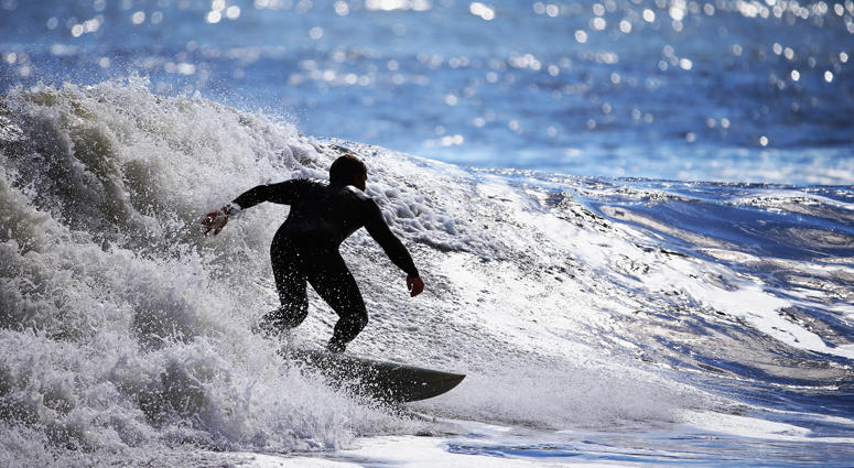 Surfing Off Log Island