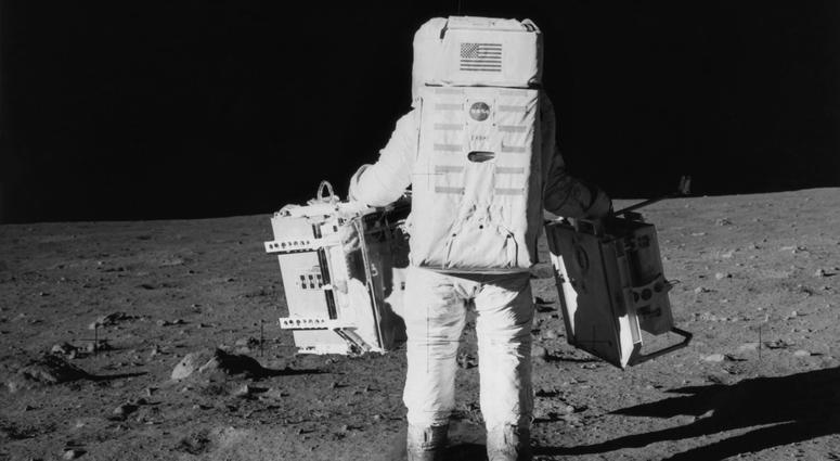 Edwin 'Buzz' Aldrin Jr. prepares to deploy part of the Early Apollo Scientific Experiments Package on NASA's Apollo 11 lunar landing mission.