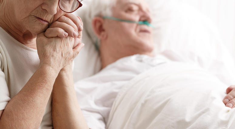 Elderly couple in a hospital room.