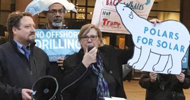 Judith Enck, center, former regional administrator for the Environmental Protection Agency addresses those gathered at a protest against President Trump's plan to expand offshore drilling for oil and gas in Albany, N.Y.