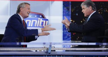 """Fox News host Sean Hannity, right, interviews Democratic presidential candidate and New York Mayor Bill de Blasio during a taping of his show, """"Hannity,"""" Wednesday, Aug. 7, 2019, in New York"""