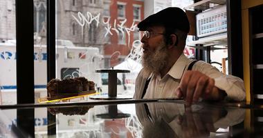 Moishe Perl inside Moishe's Bake Shop