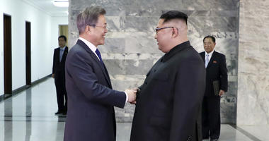In this photo provided by South Korea Presidential Blue House via Yonhap News Agency, North Korean leader Kim Jong Un, right, and South Korean President Moon Jae-in, left, shake hands