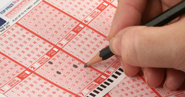 Person filling out lottery ticket