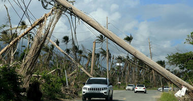 Downed electrical poles at Playa Punta Santiago in Humacao, Puerto Rico in December 2017
