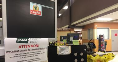 A flyer in Shoprite warns food stamp recipients that February funds will be issued in January