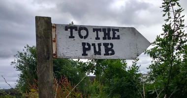 A sign pointing the way to the pub