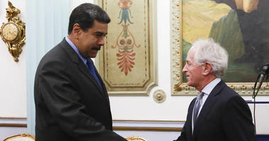 In this photo released by the Miraflores Presidential Press Office, Venezuela's President Nicolas Maduro, left, shakes hands with Republican Senator Bob Corker during a meeting at the Miraflores Presidential Palace in Caracas,