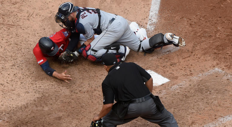 Indians throw out Adrianza at the plate