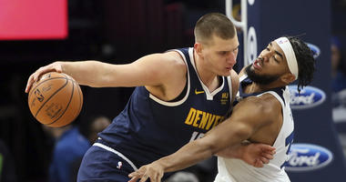 Jokic, Nuggets hold on for 100-98 overtime win over Wolves