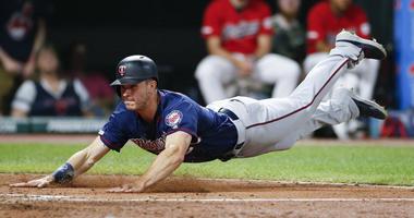 Max Kepler dives for the go-ahead run