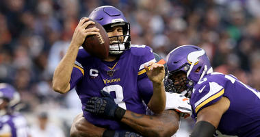 Vikings quarterback Kirk Cousins is sacked in Chicago