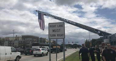 Flag over funeral procession for Joseph Gomm