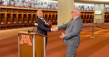 WATCH: PJ Fleck presents Governor Tim Walz Penn with the game ball from Gophers victory over Penn State