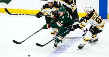Wild forward Ryan Donato takes on the Bruins
