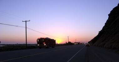 Fire fighters in trucks