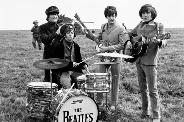 John Lennon, Ringo Starr, Paul McCartney and George Harrison on Salisbury Plain during the filming of 'Help
