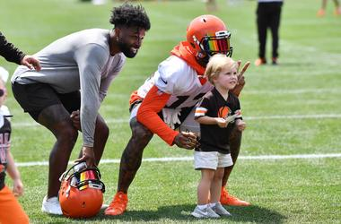 Cleveland Browns wide receiver Jarvis Landry (left) and wide receiver Odell Beckham (13) pose for a photo with a fan after training camp at the Cleveland Browns Training Complex.
