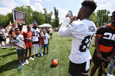 Cleveland Browns wide receiver Rashard Higgins (81) takes a photo of wide receiver Odell Beckham (13) and fans during training camp at the Cleveland Browns Training Complex.